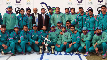 The victorious Rawalpindi team pose with the Quaid-e-Azam trophy
