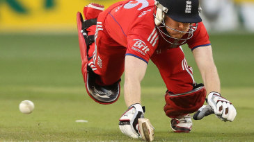 Eoin Morgan appeared to make his ground with a dive but his bat was in the air
