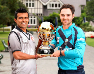 Khurram Khan and Preston Mommsen pose with the World Cup 2015 Qualifier trophy on the eve of the final between UAE and Scotland in Lincoln © IDI/Getty Images