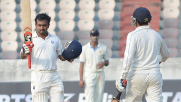 Kedar Jadhav raises his bat after scoring a hundred