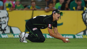Mitchell Starc took a low catch to dismiss Eoin Morgan