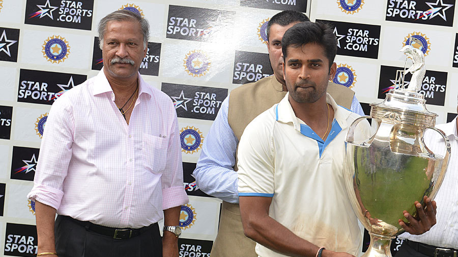 Karnataka captain Vinay Kumar holds the Ranji Trophy