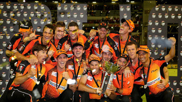 Confetti rains down on the Perth Scorchers players as they celebrate winning the Big Bash League