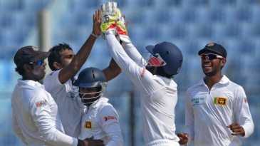 Dilruwan Perera is congratulated by Dinesh Chandimal after a wicket