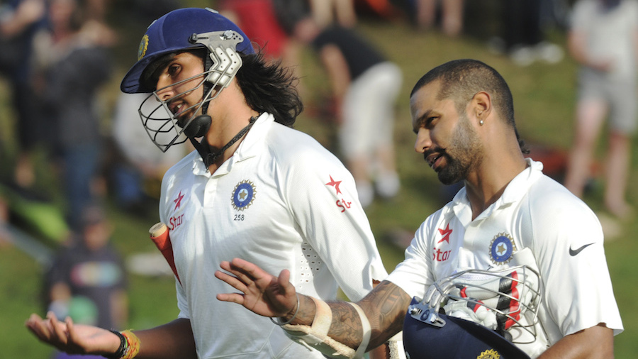 Ishant Sharma and Shikhar Dhawan walk back at the close of play