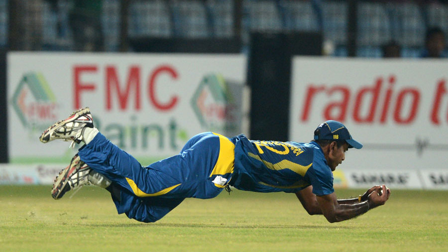 Nuwan Kulasekara takes a diving catch