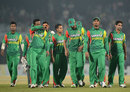 A disappointed Bangladesh team walk off after a second last-ball defeat in three days, Bangladesh v Sri Lanka, 2nd T20I, Chittagong, February 14, 2014