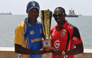 Dwayne Bravo and Kevin Stoute pose with the tournament trophy, Barbados v Trinidad & Tobago, Nagico Super50 final, Port of Spain, February 15, 2014