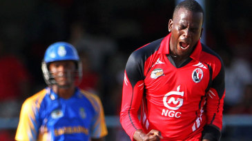 Kevon Cooper exults after taking a wicket