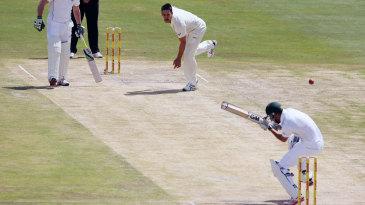 Robin Peterson ducks a short ball by Mitchell Johnson