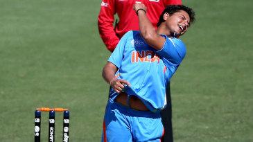 Kuldeep Yadav celebrates after dismissing Nick Farrar