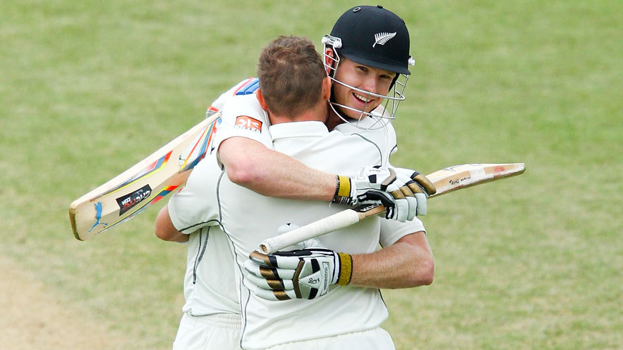 Brendon McCullum and Jimmy Neesham fall into an embrace