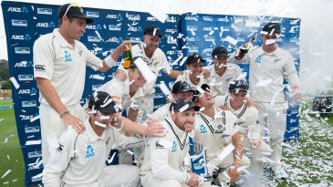 The New Zealand players celebrate after winning the series