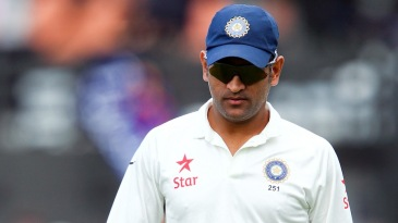 MS Dhoni walks back for the lunch break