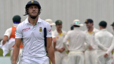 Faf du Plessis walks back after being dismissed