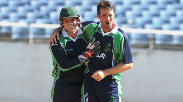 Gary Wilson and Tim Murtagh celebrate a wicket