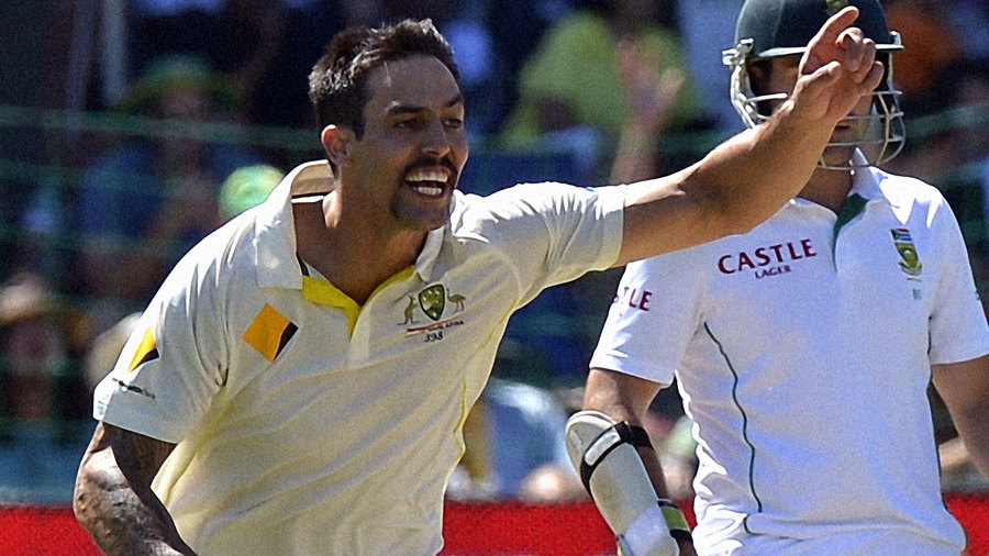 Mitchell Johnson exults after removing Graeme Smith