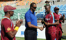 Miguel Cummins gets his ODI cap from Courtney Walsh, West Indies v Ireland, only ODI, Kingston, February 23, 2014