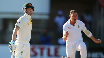 Michael Clarke looks back after edging to second slip