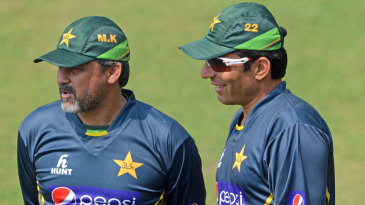 Moin Khan and Misbah-ul-Haq chat during a practice session