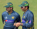 Moin Khan and Misbah-ul-Haq chat during a practice session, Mirpur, February 24, 2014
