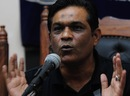 Rashid Latif gestures during a press conference, Karachi, August 24, 2013
