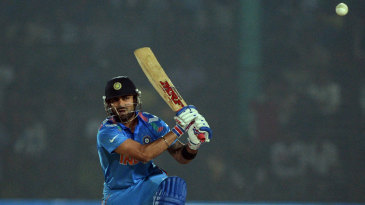 Virat Kohli drives down the ground