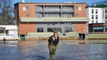 Groundstaff battle the floods at New Road