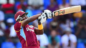 Airborne: Dwayne Bravo puts all his power into a pull