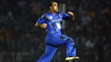 Samiullah Shenwari celebrates a wicket