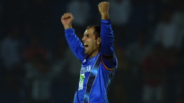 Mohammad Nabi exults after taking the final wicket