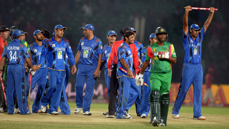 The Afghanistan players celebrate their landmark win