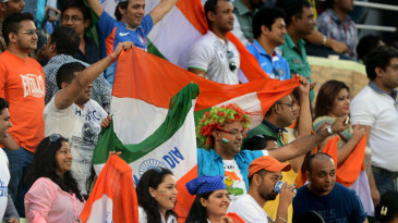 Indian fans cheer on their side
