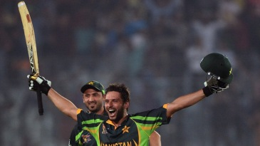 Shahid Afridi is joined by team-mates after winning the match