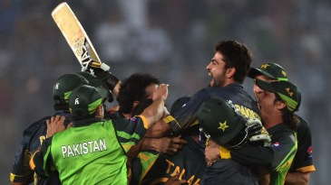 Shahid Afridi is mobbed by his team-mates