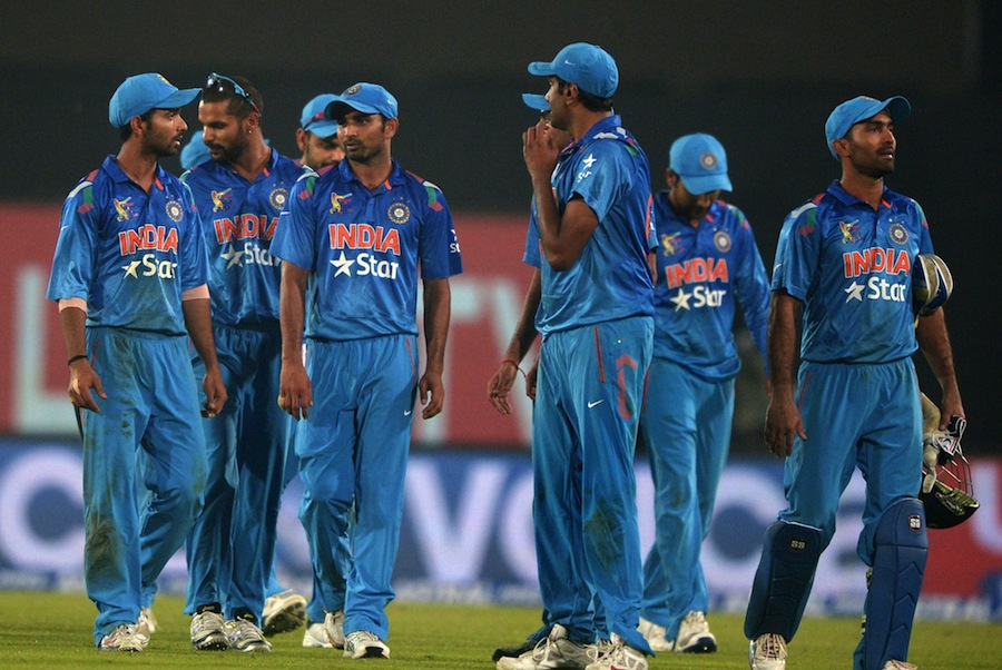 A dejected India team after losing the match