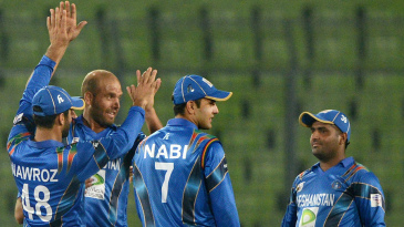 Mirwais Ashraf is congratulated after dismissing Ajinkya Rahane