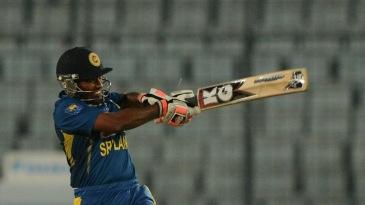 Ashan Priyanjan sends the ball in the air