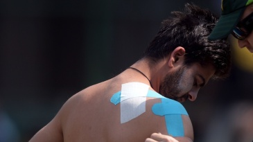 Ahmed Shehzad gets his shoulder taped