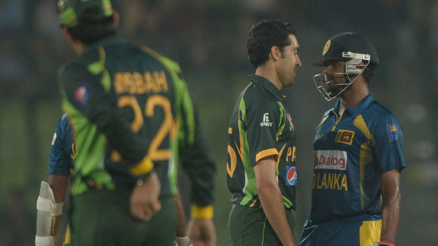 Umar Gul and Lahiru Thirimanne exchange words