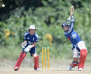 Bruce French gets back behind the stumps as Jos Buttler bats, Isolation Cricket Club, Barbados, March 8, 2014