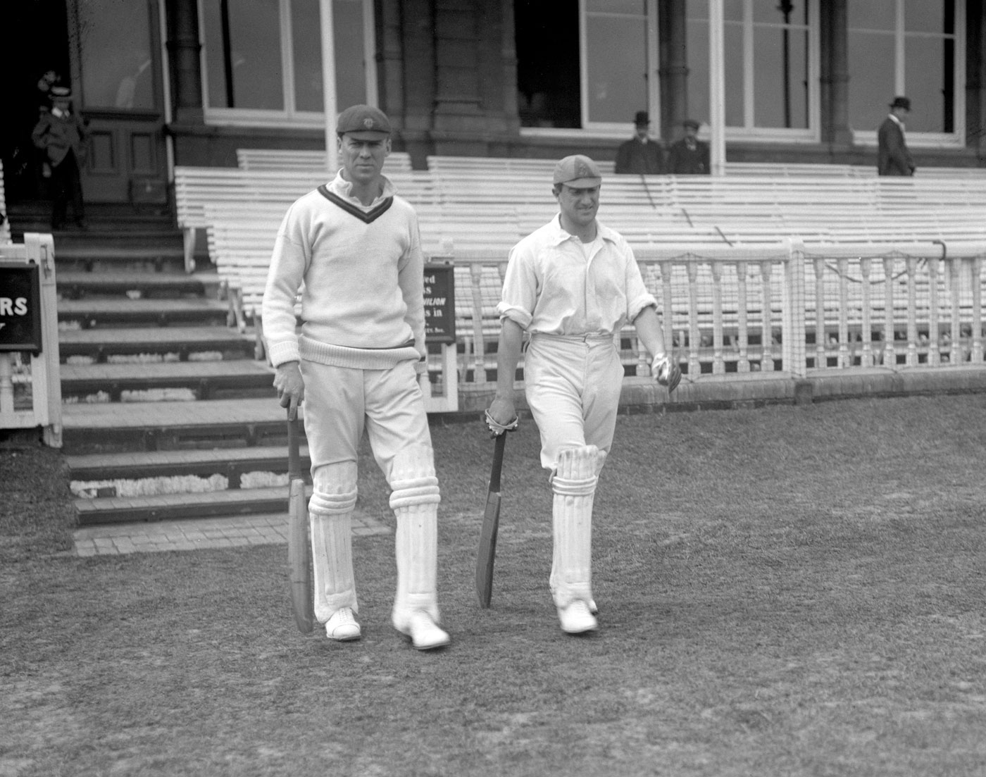 Faulkner (right) walks out to bat with Jimmy Sinclair at Lord's in 1907. On that tour, Faulkner had match figures of 9 for 75 during the Headingley Test