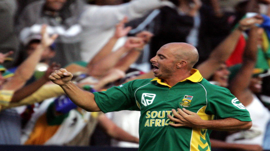 Herschelle Gibbs celebrates with fans after masterminding South Africa's astounding chase
