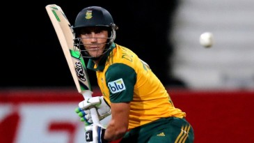 Faf du Plessis watches the ball closely