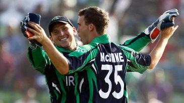 Andy McBrine celebrates a wicket with Gary Wilson