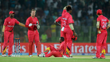 Zimbabwe's players react after Ireland win the match with a stolen bye off the last ball