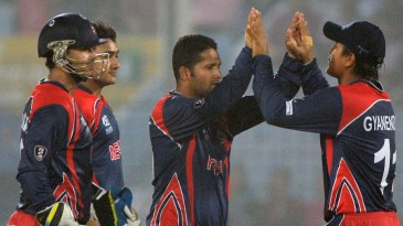 Basant Regmi is congratulated after dismissing Tamim Iqbal