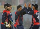 Basant Regmi is congratulated after dismissing Tamim Iqbal, Bangladesh v Nepal, World T20, Group A, Chittagong, March 18, 2014