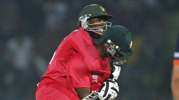 Vusi Sibanda and Timycen Maruma celebrate Zimbabwe's win