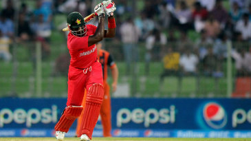 Hamilton Masakadza hits over the top during his innings of 43